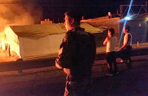 ¡Rescatan elementos de la Fiscalía General a familia atrapada en una casa que se incendiaba en Zapopan!